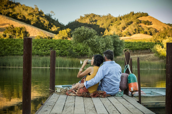 people-lake-doc-couple-drinking-wine
